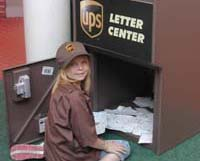 UPS worker gathers mail